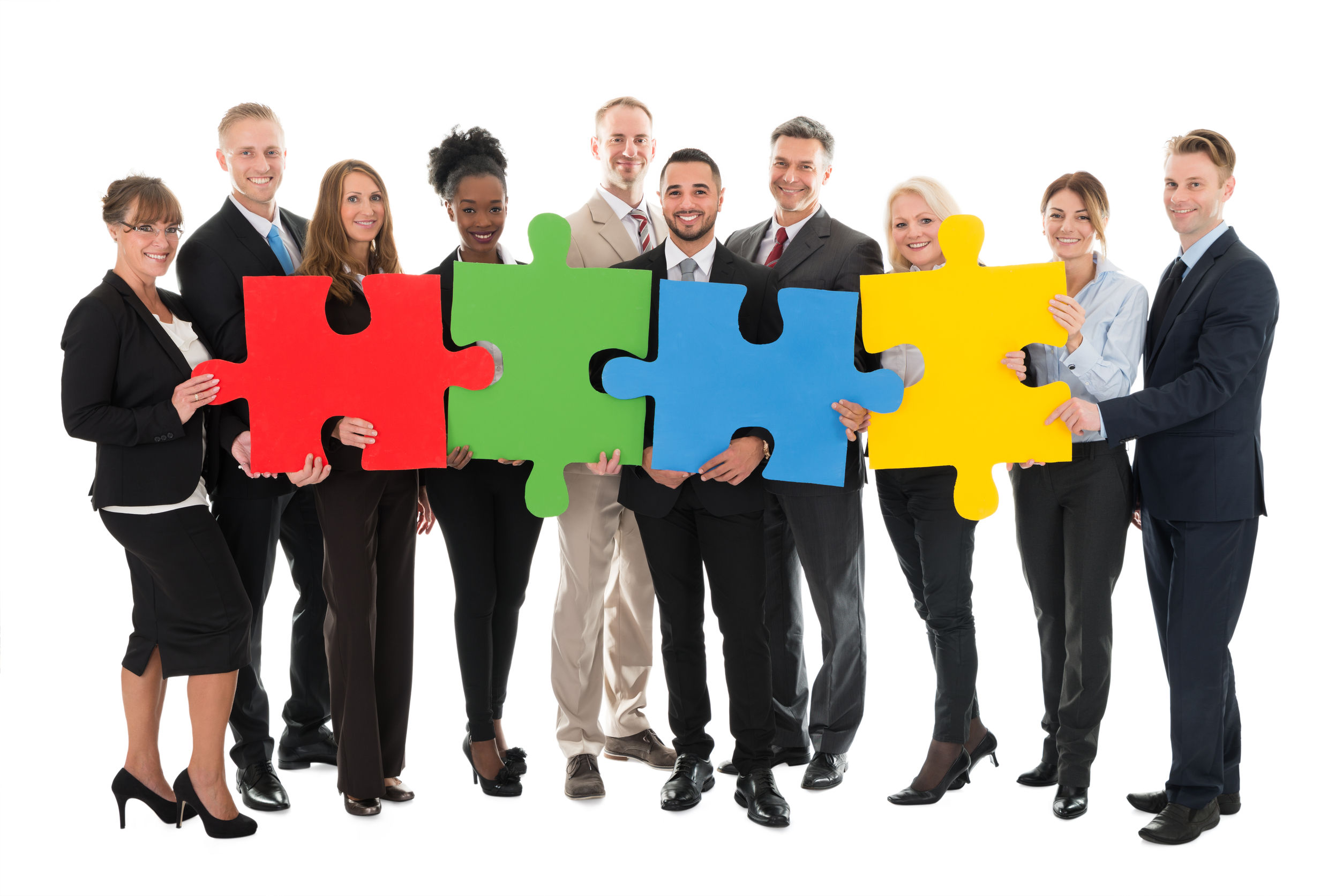 50244323 - full length portrait of happy business team holding jigsaw pieces against white background